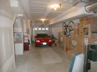 First View Of The Two Car Tandem Garage With High Ceilings